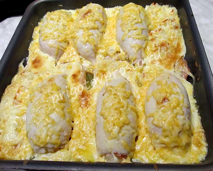 Фаршированные кальмары в духовке с рисом
